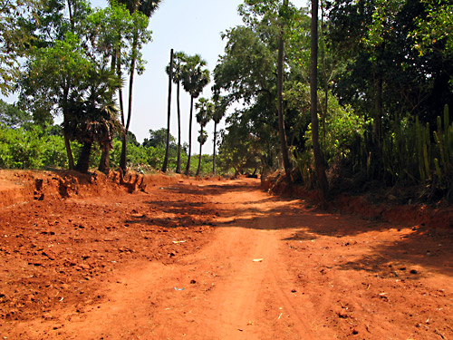 Red earth road under construction.