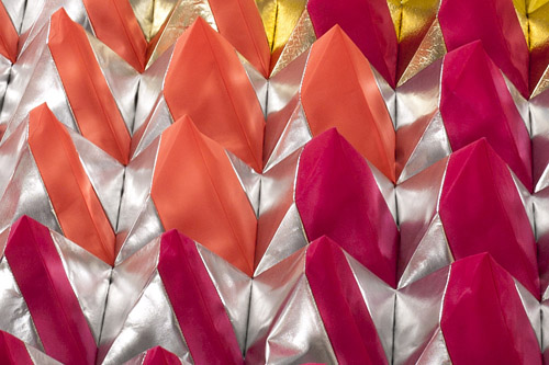Silver, orange, and fuschia Polytopia cones