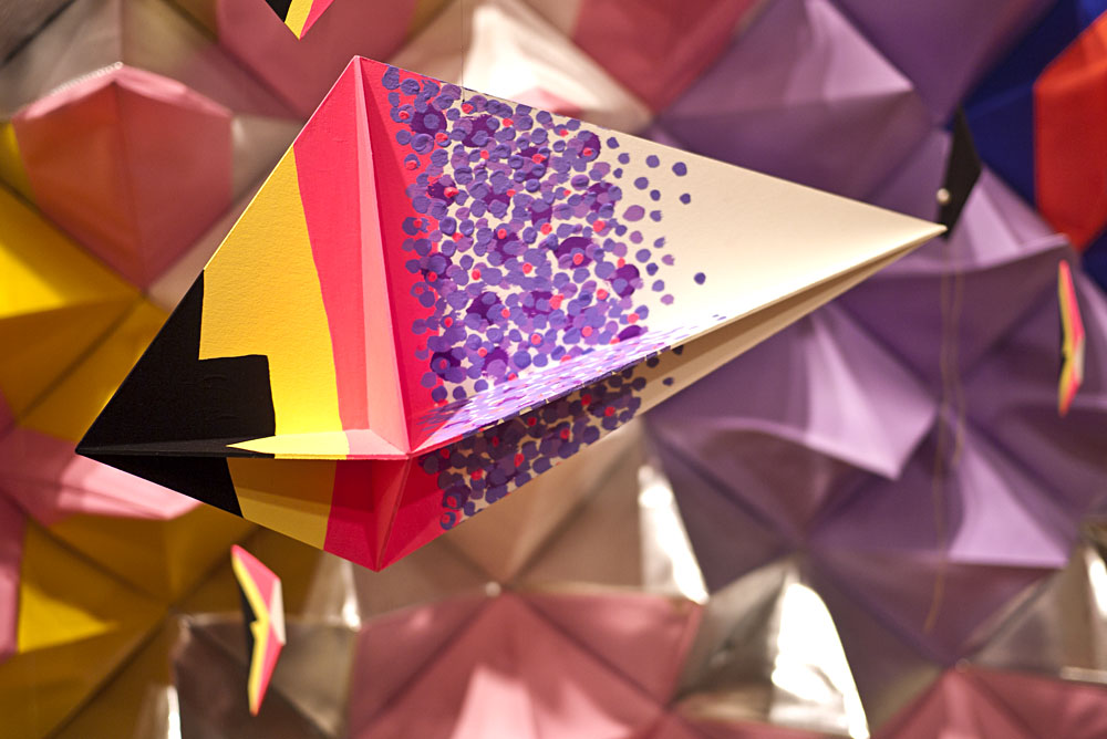Purple and yellow paper sculpture called Geom Fish.