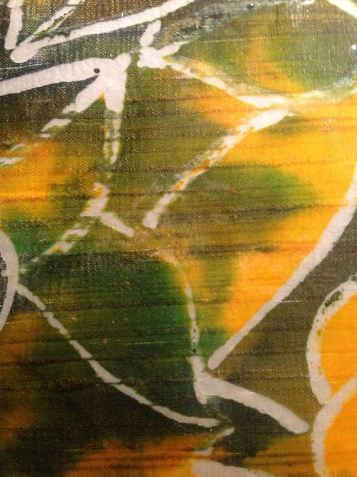 Batik panel close up showing yellow and green colours.