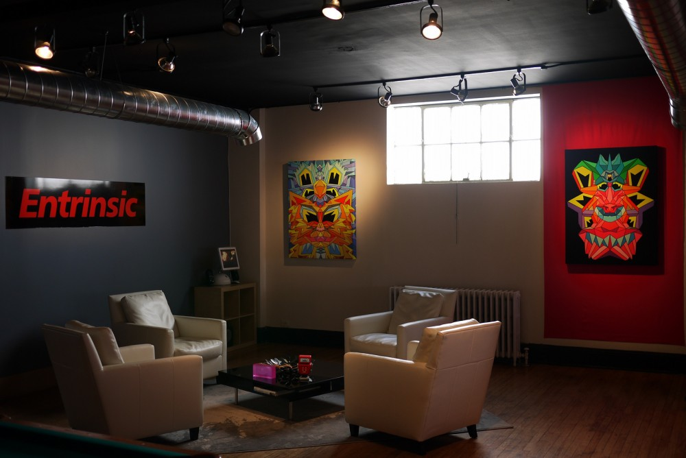 Loft office lobby with two paintings.
