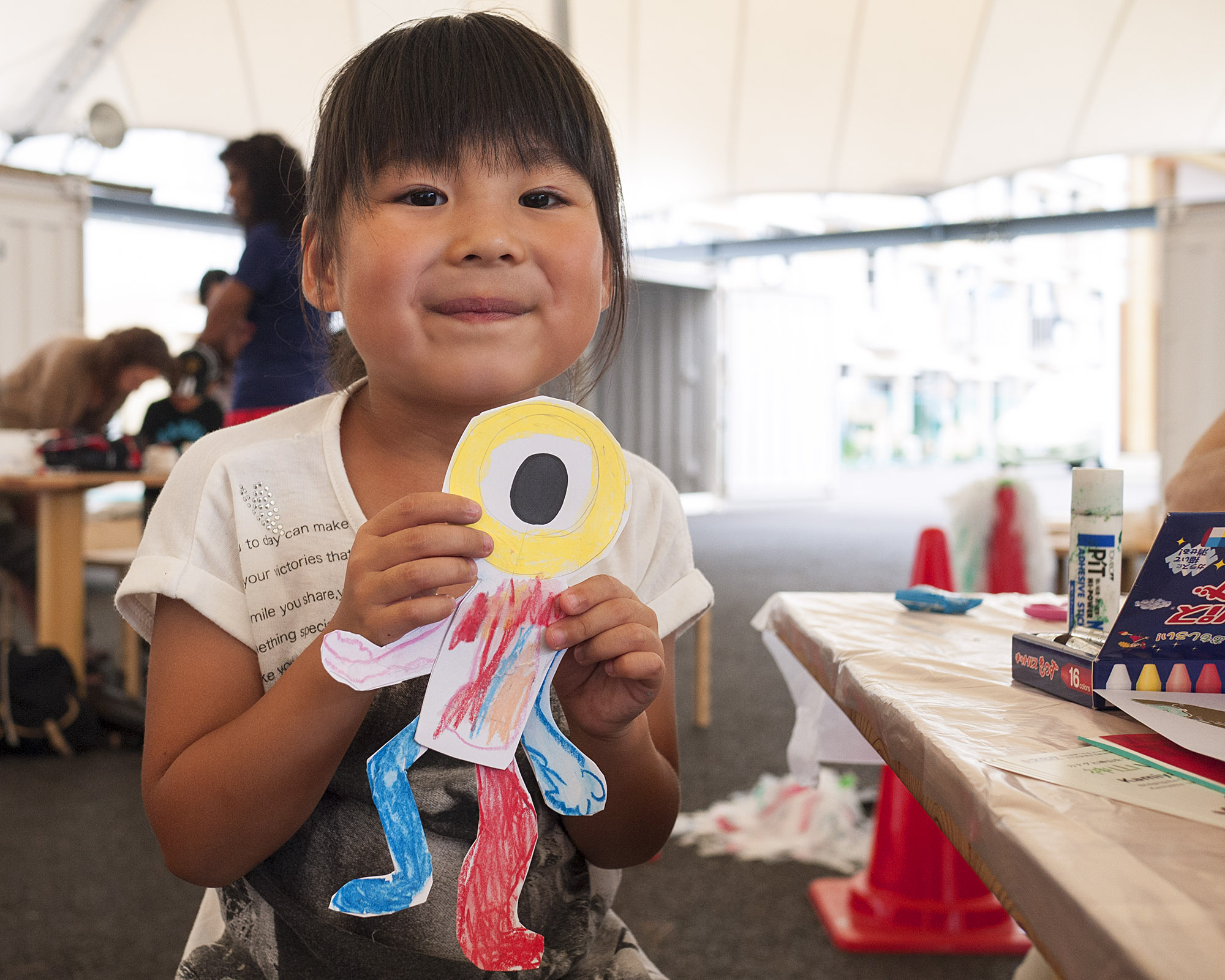 A little Onagawa girl holds a puppet she made in Marc's workshop.