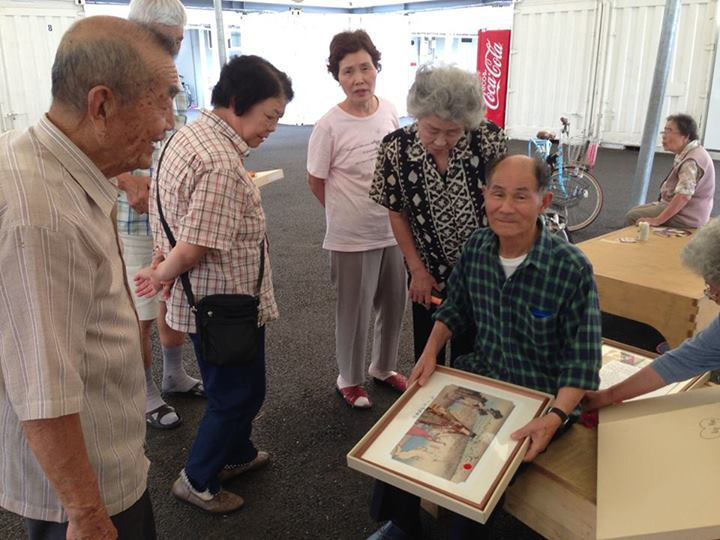 Temporary housing residents receive the art they made after the exhibition.