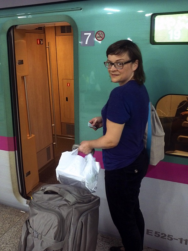 Magda getting on the bullet train