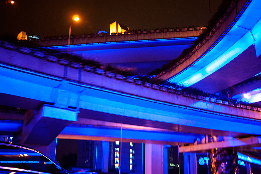 Shanghai highway underlit with blue light