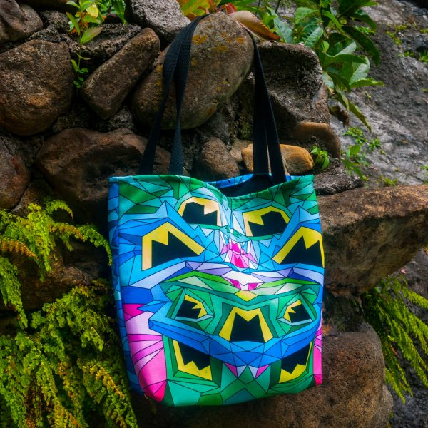 Colorful geometric bag with long straps.