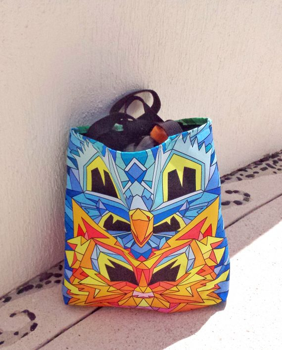 Colorful book tote with geometric cat design