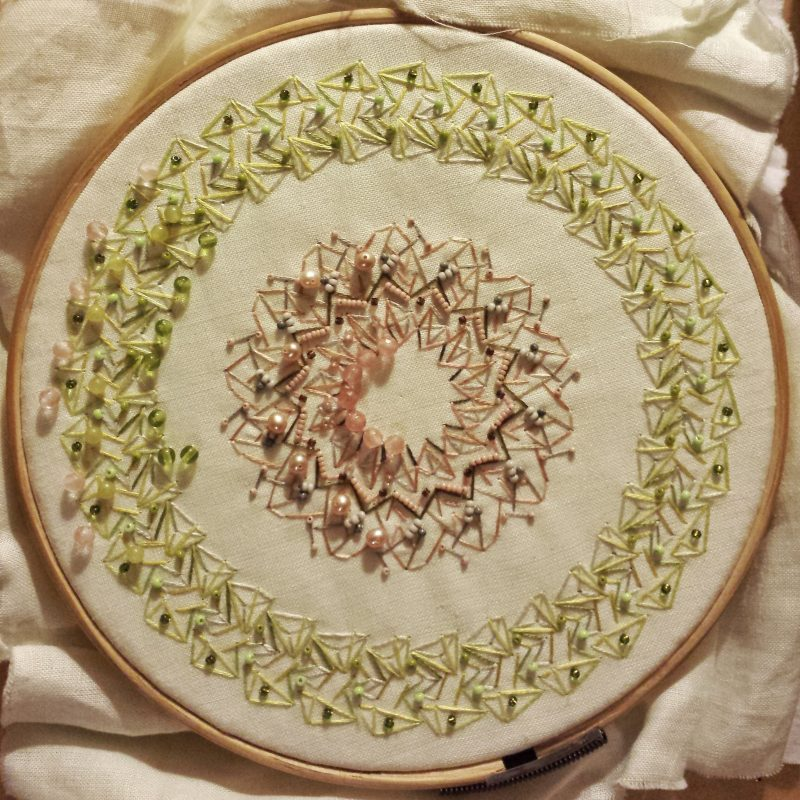 Light green mandala with pearls