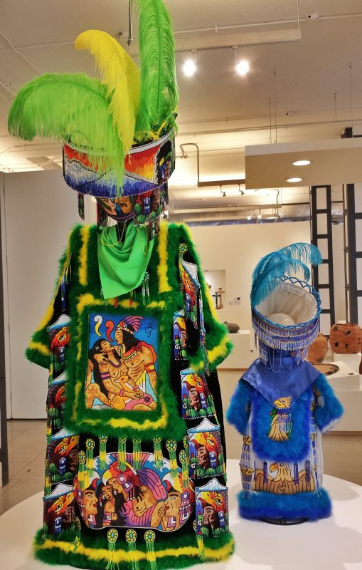 Back view of the adult and child costumes.