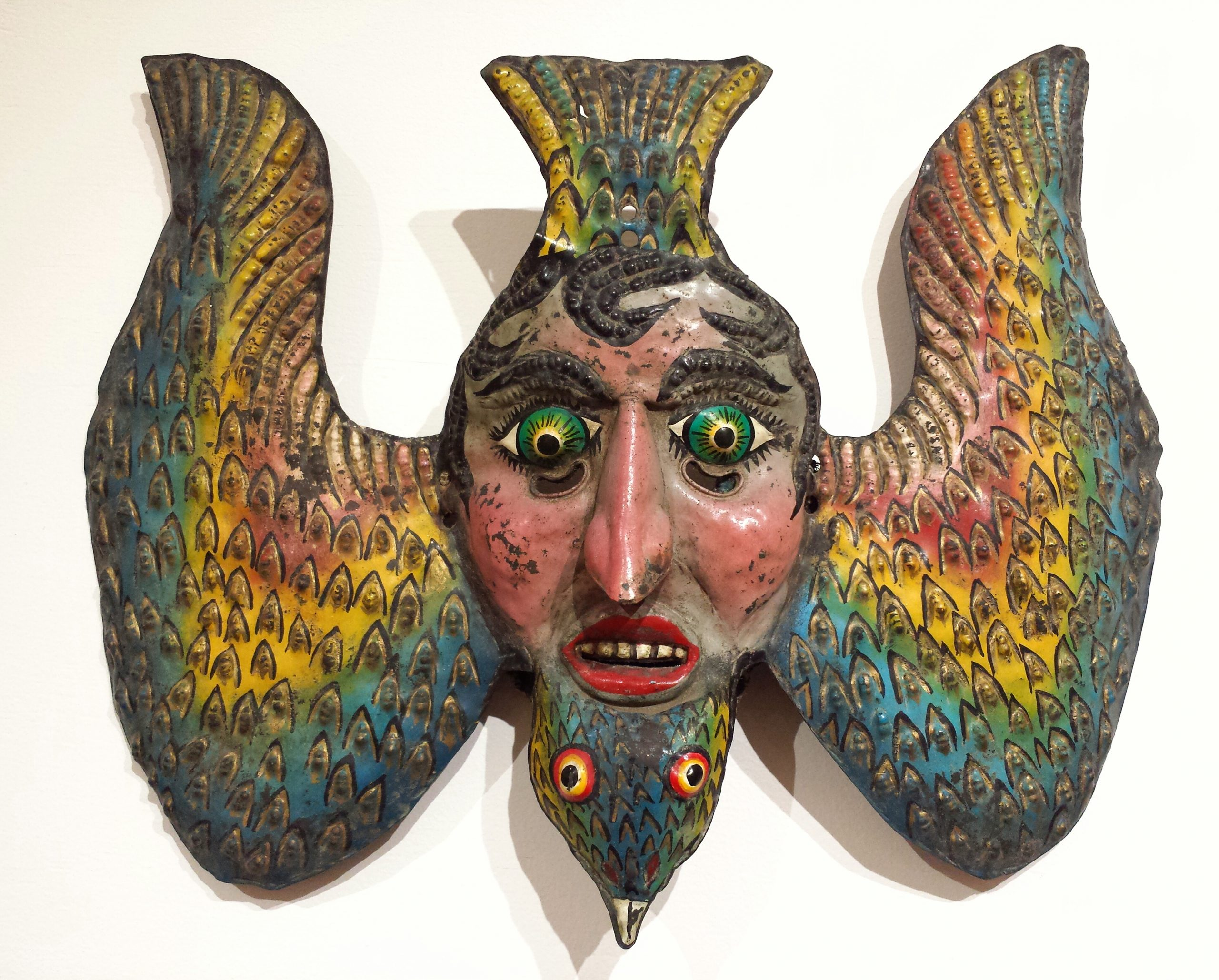 Carved wood bird and face mask from Mexico
