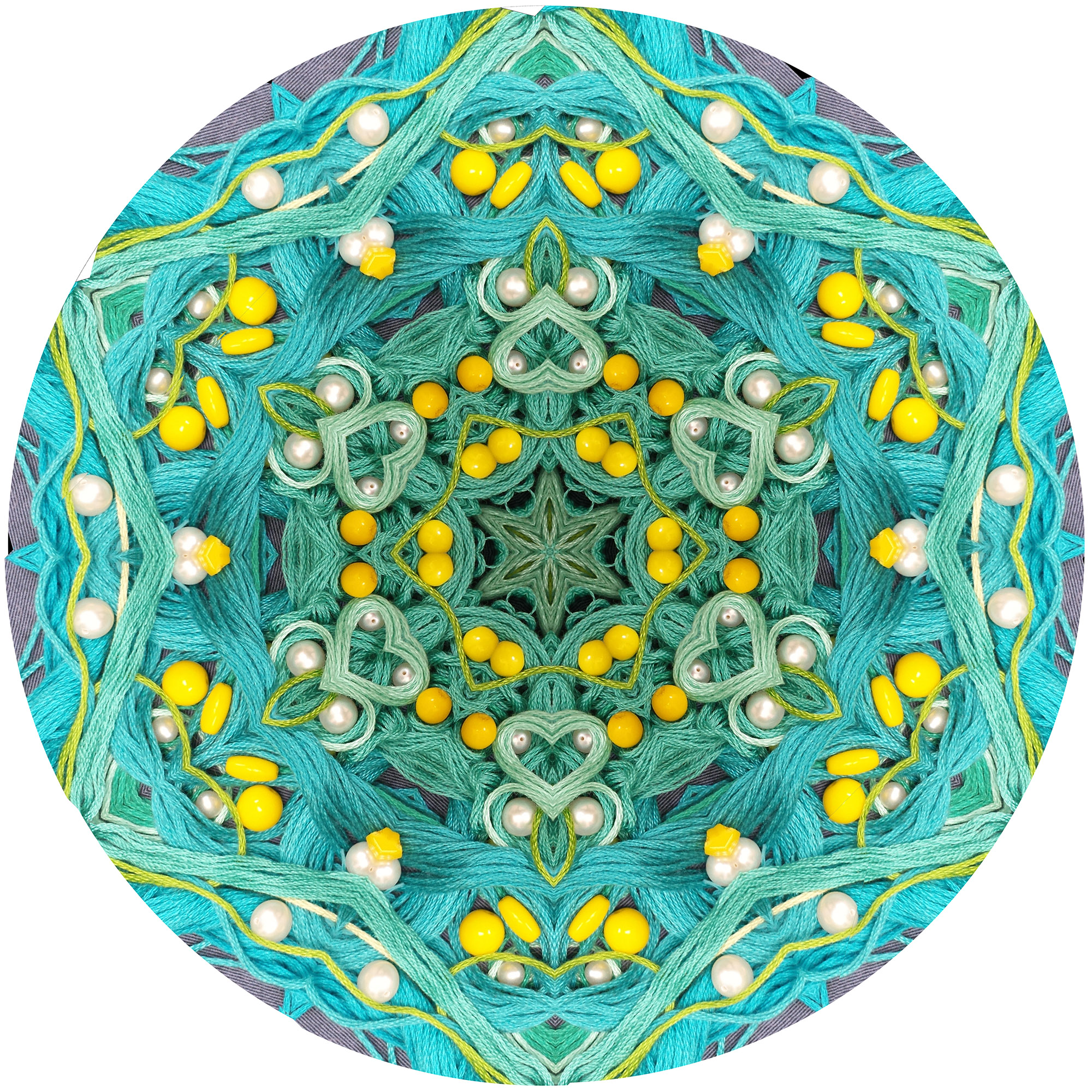 Thread, pearls, and yellow beads mandala
