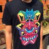 black t-shirt with coloful geometric print of Crystal Kings monsters