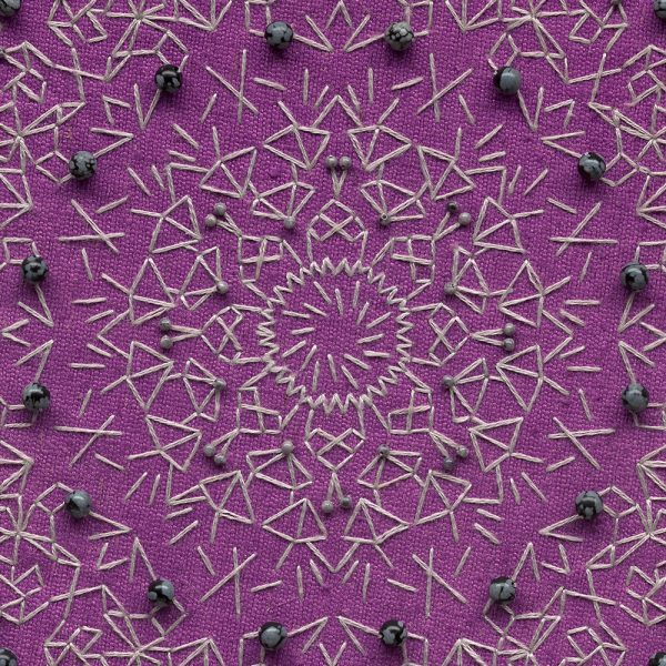 Purple and grey embroidered kaleidoscopic mandala textile art, detail