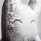 White and silver textile sculpture eyes