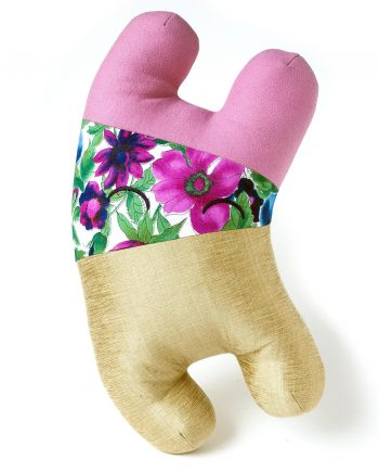 Stuffed animal by Magda Wojtyra in pink wool, gold silk, and flower pattern
