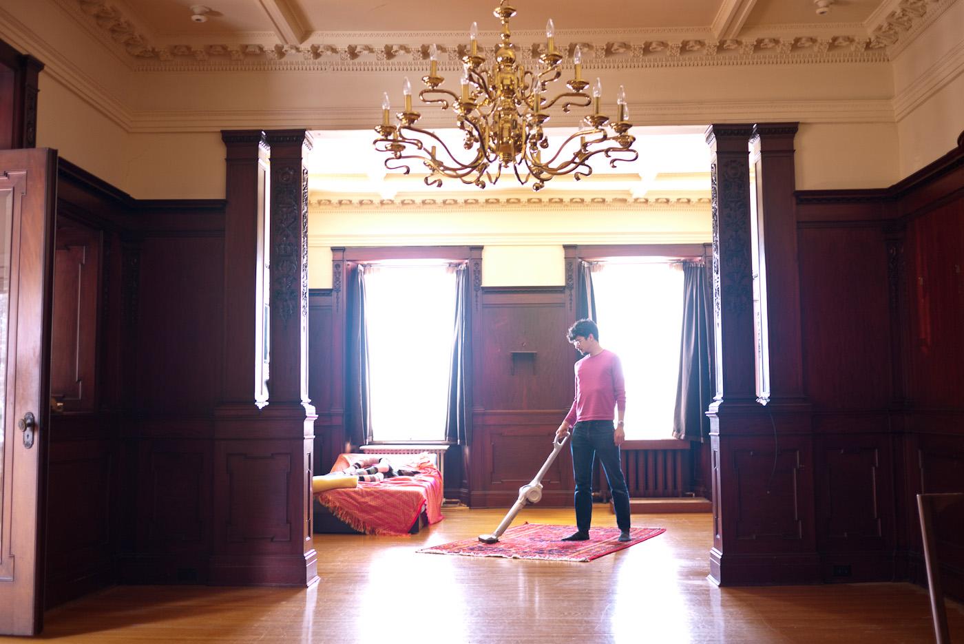 Marc vacuuming mansion