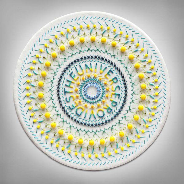 Fine art print of embroidered mandala on white linen with turquoise and yellow beads