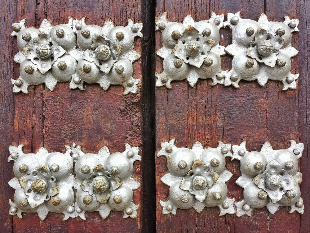 Metal rosette studs on a wood door detail