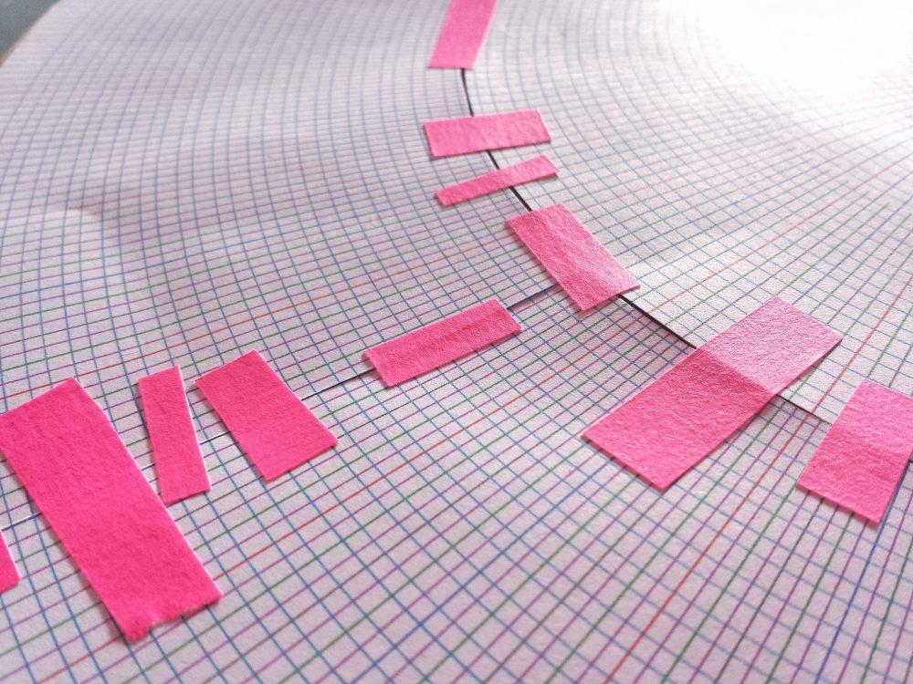 Pink tape round paper grid