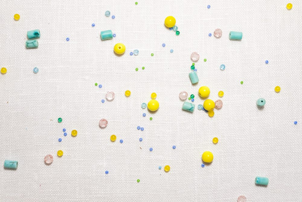 Yellow pink and blue beads landscape on linen