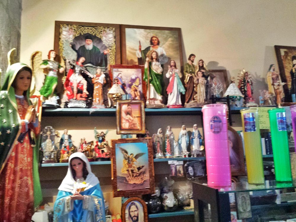 statues, paintings, candles, rosaries
