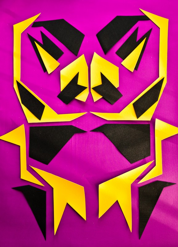 Black and purple geometric fabric scraps arranged into a robot monster.