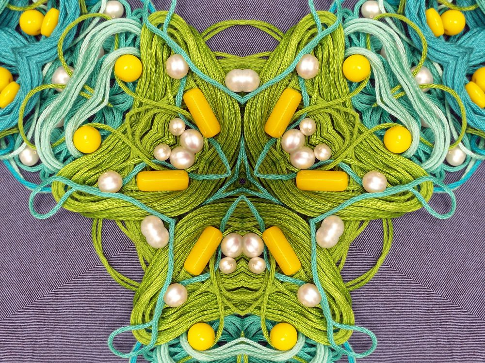 Thread, pearls, and yellow beads mandala